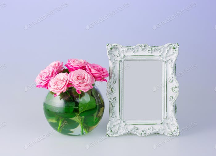 Flowers vase and vintage frame