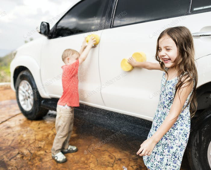 Kids helping to wash a car