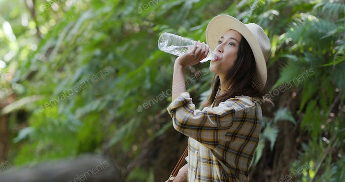 Woman drink of water when hiking