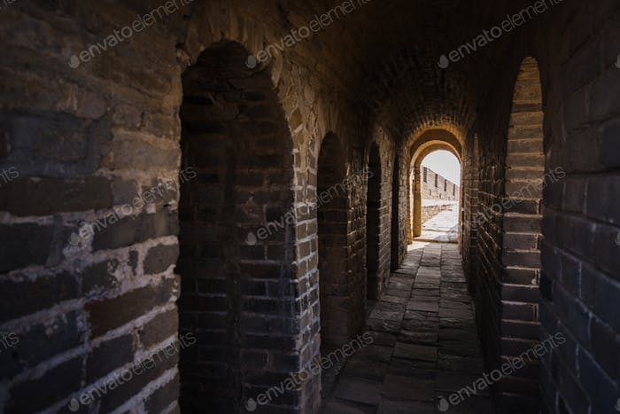 long stone corridor with stairway in ancient castle or wall