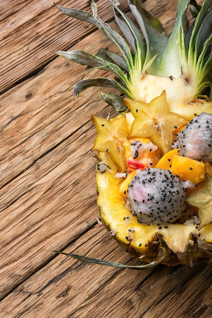 tropic fruits salad in pineapple