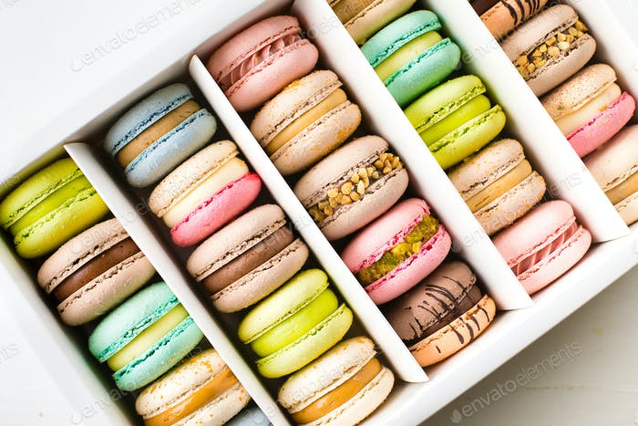 Colourful french macaroons on white background. Top view