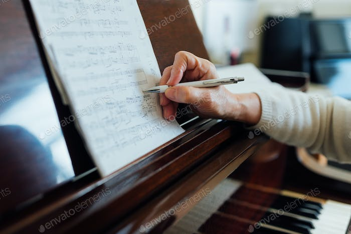 writing notes on sheet music