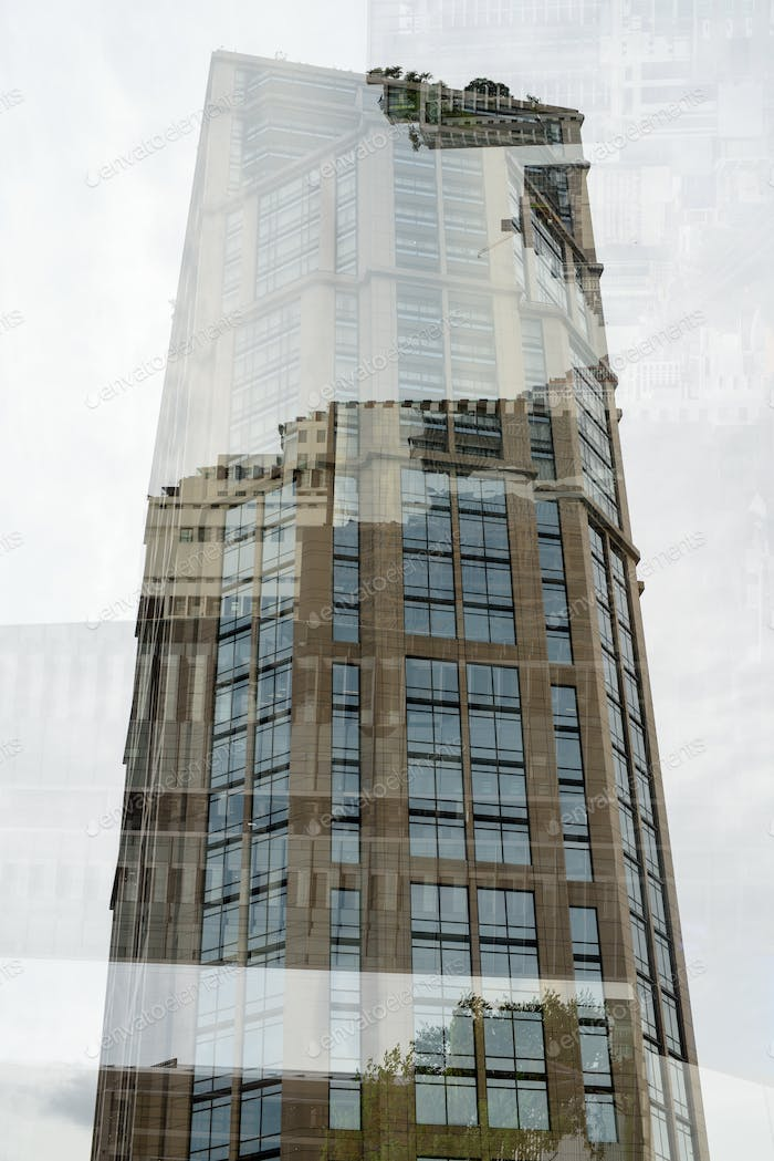 Portrait Of Tall Corporate Buildings In Multiple Exposure