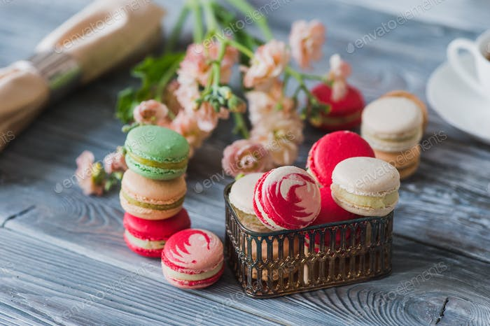 Love gift with flowers and macarons