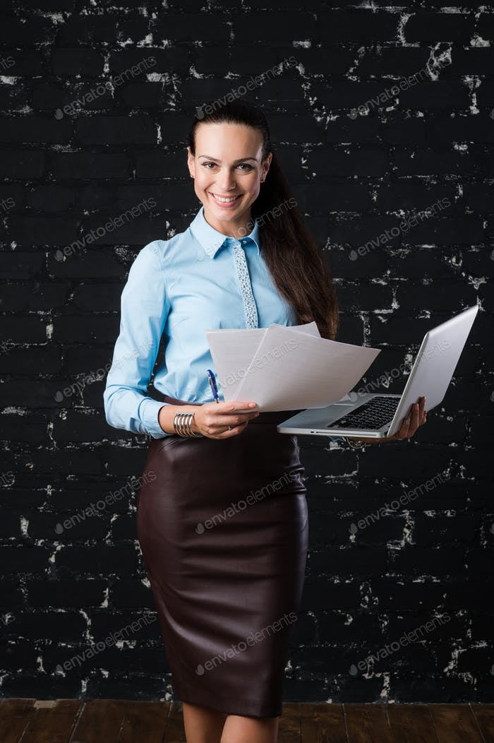 Portrait of a young business woman looking at camera