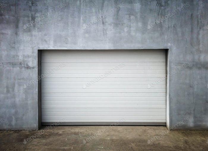 New Modern Garage Door in Unfinish Exterior Concrete Wall