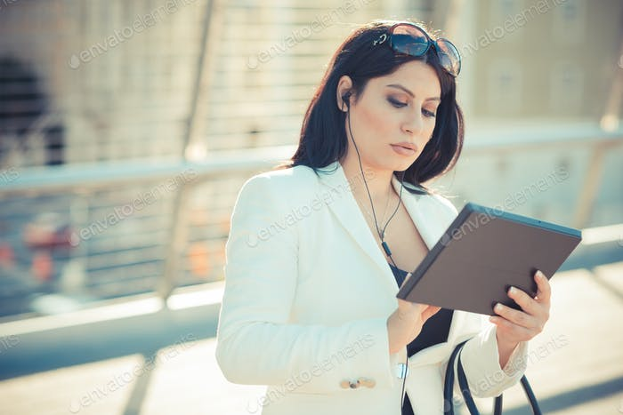 beautiful long black hair elegant business woman with tablet