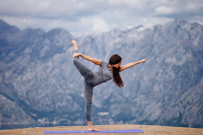 woman yoga pose outside