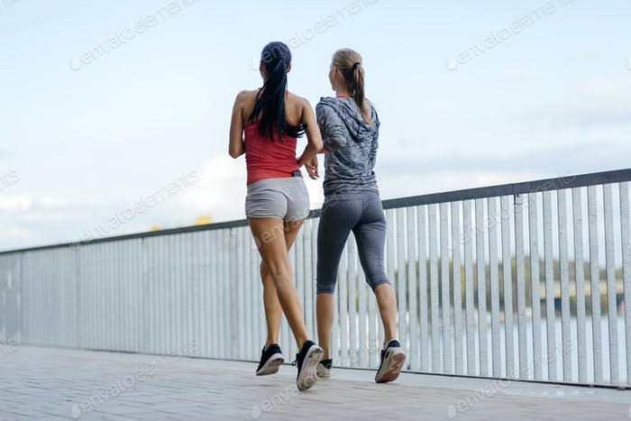 Exercising by jogging in city