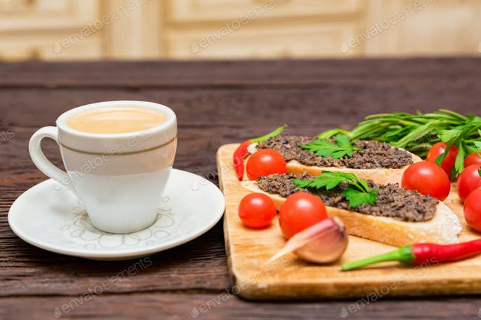 Fresh tasty bruschetta with truffle sauce, parsley, tomates and cup of coffee