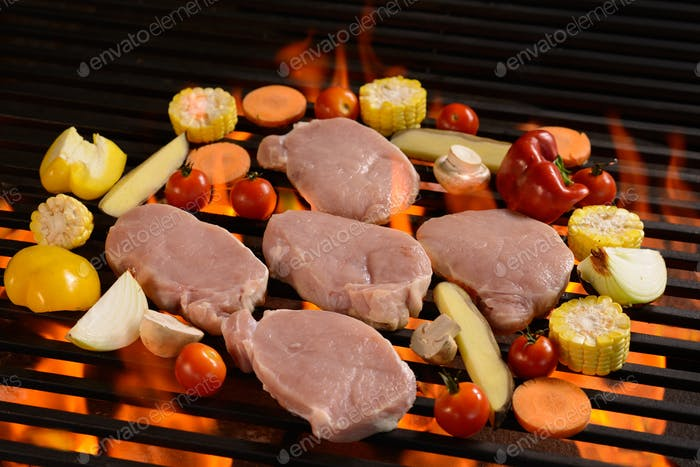 Grilled raw meat /steak with vegetable on the flaming grill