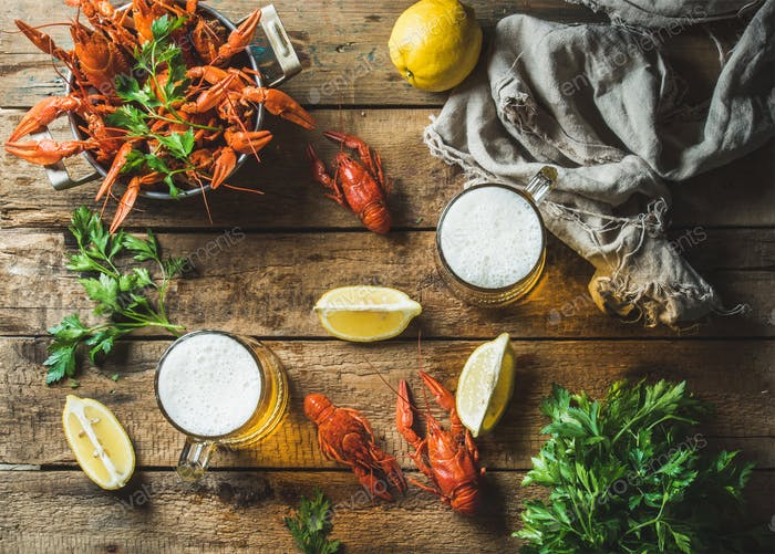 Wheat beer and boiled crayfish with lemon, parsley