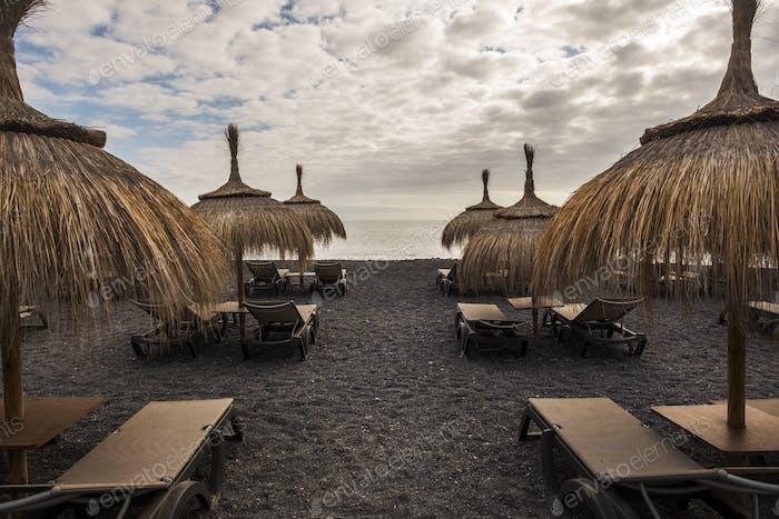 umbrellas and seats on the beach in tenerife island