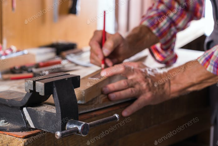 Carpenter working on the work bench, joinery tools and woodwork