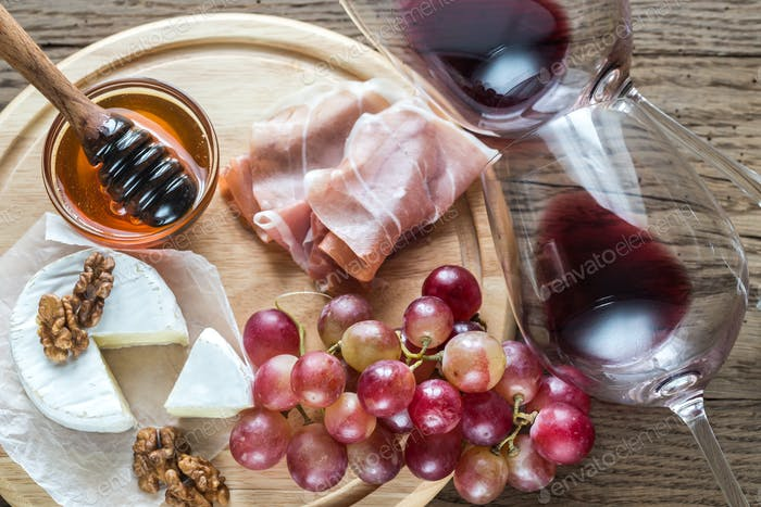 Camembert cheese with glasses of red wine