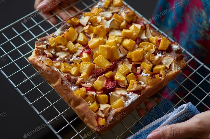 Homemade fruit cake on a cooling rack