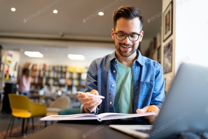 Student preparing exam and learning lessons in school library