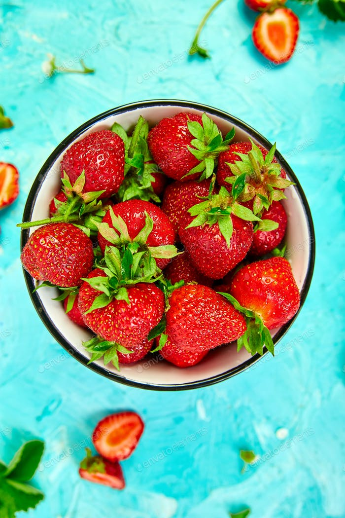 Strawberries in red bowl.