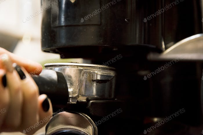 preparing coffee in automatic coffee machine