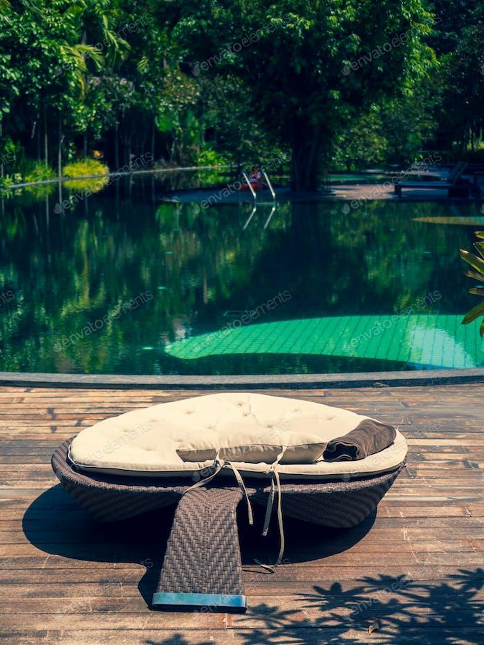 luxury swimming pool at tropical hotel resort