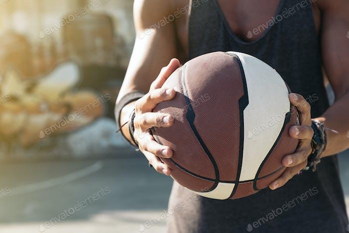 Man holding basket ball.