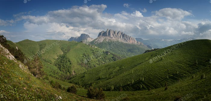 Caucasus mountains (Eastern and Western Acheshbok) under a blue
