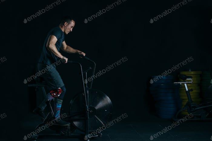 Man doing calorie assault exercise