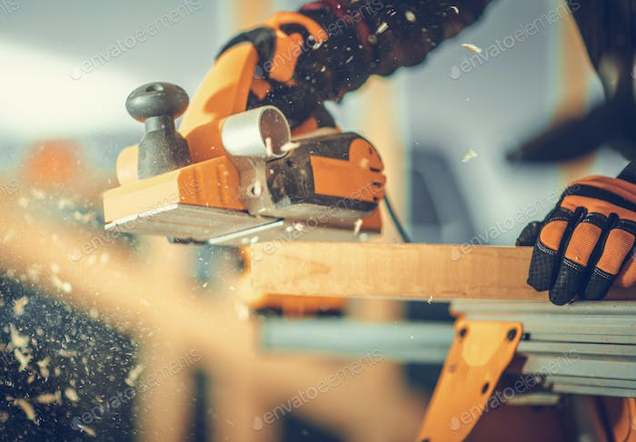 Carpenter with Corded Planer