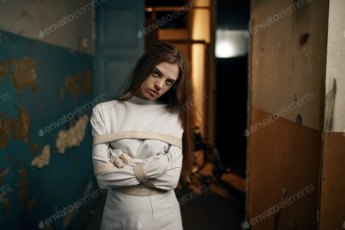 Female patient in strait jacket, mental hospital
