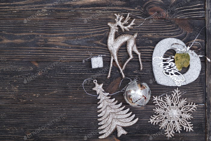 Christmas decoration on dark wooden board. Top view
