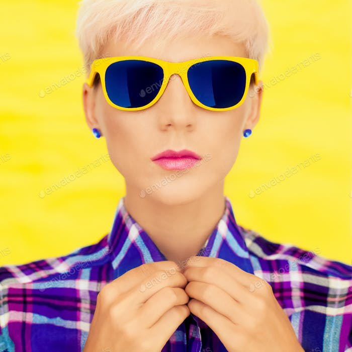 fashion portrait of a girl in fashion sunglasses