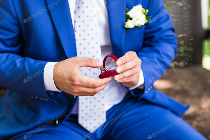 Man holding box with ring