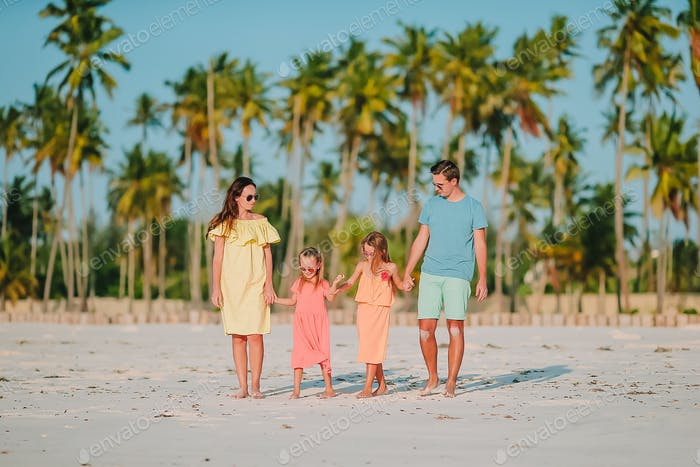Young family on vacation on the beach