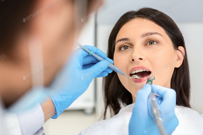 Close up of female patient during treatment at dentist