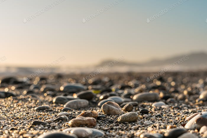Close up stone background with blurred sky on the horizon