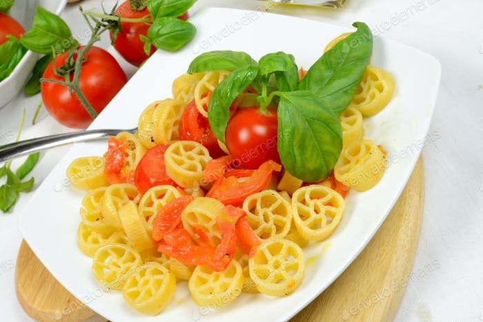 Thumbnail for wheels of pasta with fresh tomatoes