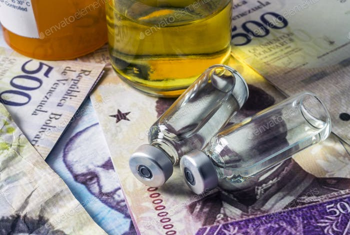 Vials with medication on banknotes Bolivarian, shady deal of medicines