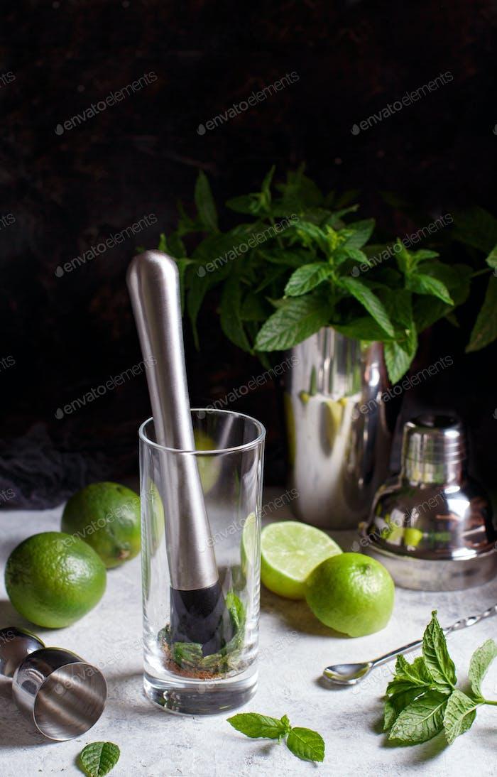 Mojito cocktail making with barmen tools