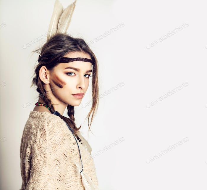 beautiful girl is in fashion style of American Indian