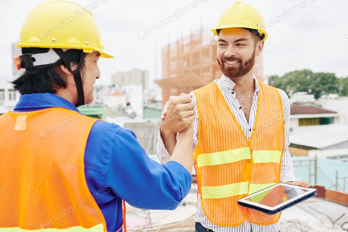 Contractor and builder shaking hands