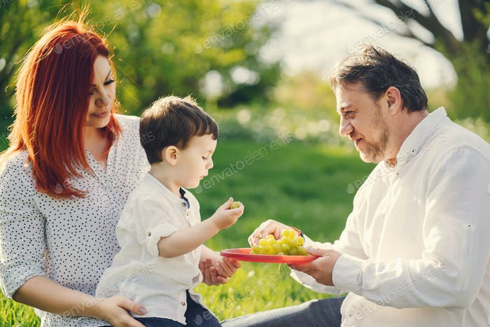 cute family sitting in a sunny park