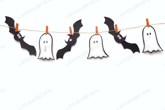 Flying black bats and ghosts hanging on rope on white