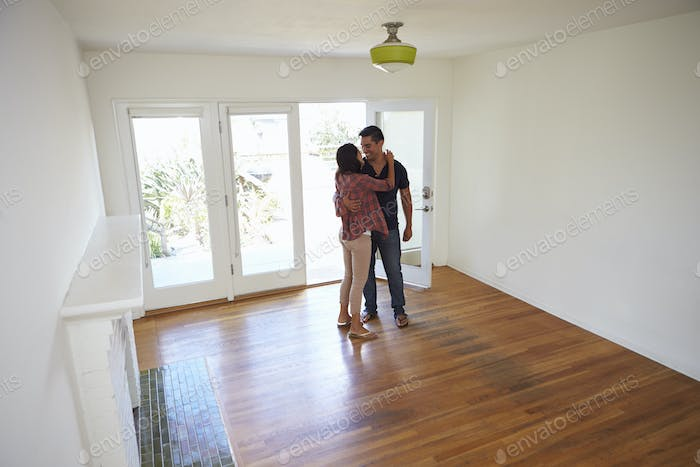 Romantic Couple In New Home On Moving Day