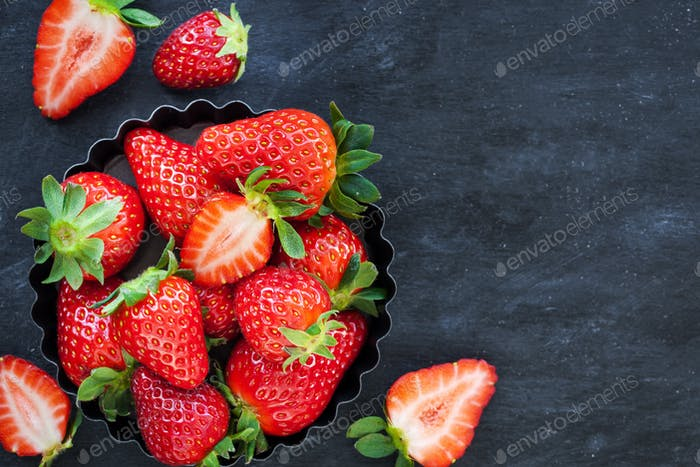 Fresh ripe strawberry on dark background