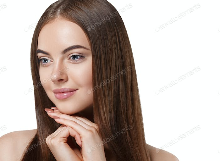 Beautiful long hair brunette woman with beauty hairstyle is touching her face by hands. Female model