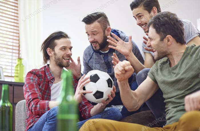 Four best friends talking about soccer match