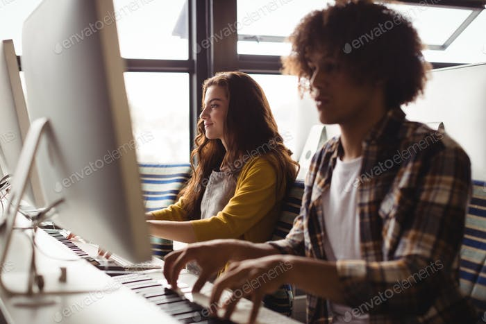 Audio engineers playing electric keyboard