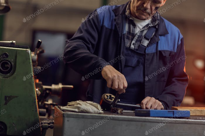 Repairman at the lathe