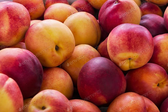 Red yellow nectarine abundance harvest background